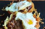 Nidos de patata con hongos y molleja de pato