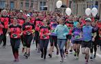 Imagen de una edición de la carrera solidaria de Anfas por las calles de Pamplona.