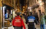 Dos agentes del dispositivo conjunto de Policía Foral y Policía Municipal de Pamplona