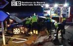 Imagen del momento del rescate del conductor de uno de los vehículos implicados en el accidente.