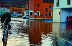 Una calle de Fitero, inundada tras la fuerte tormenta registrada ayer por la tarde.